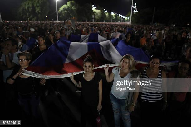 People attend a rally honoring the late Cuban leader Fidel Castro at Plaza de la Revolucion on November 29 2016 in Havana Cuba Schools and government...