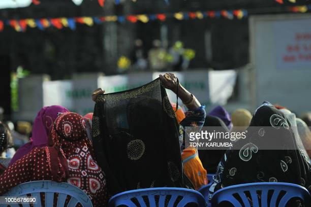 People attend a rally in support of a planned national referendum by the administration of current President on July 26 2018 in Moroni the federal...