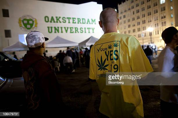 People attend a rally in support of a proposal to legalize marijuana outside Oaksterdam University in Oakland California US on Tuesday Nov 2 2010...