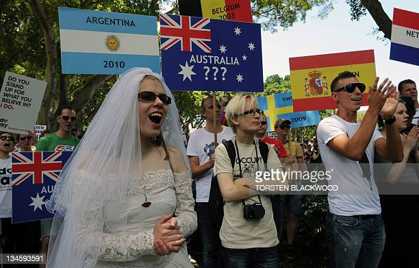 People attend a rally in support of samesex marriages in Sydney on December 3 2011 Australia's ruling Labor Party on December 3 agreed to support gay...