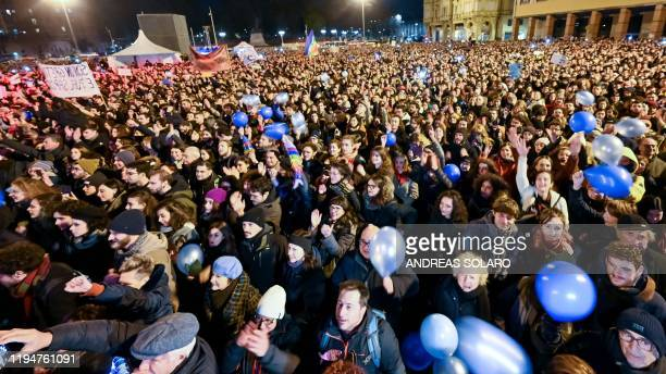 People attend a rally of the antifascist Sardine Movement formed to oppose the farright League party on January 19 2020 in Bologna a week ahead of...