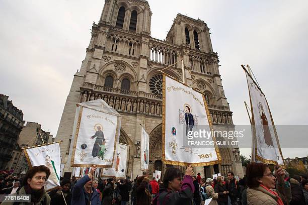 People attend a rally to commemorate the Catholic All Saints Day 01 November 2007 in front of Paris' Notre Dame cathedral AFP PHOTO FRANCOIS GUILLOT