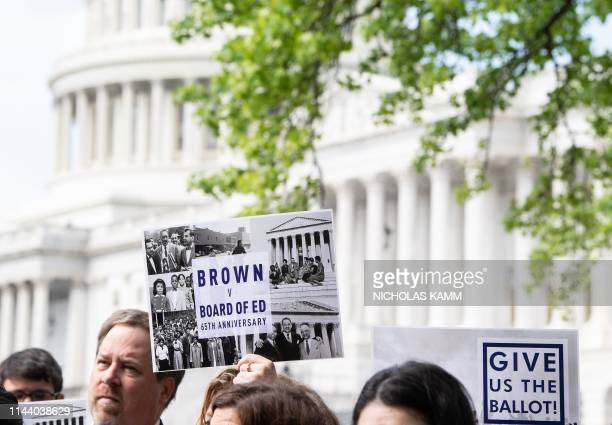 People attend a rally to mark the 65th anniversary of the US Supreme Court's Brown v Board of Education ruling that ended segregation in public...