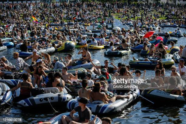 People attend a rave in boats of all sizes to give support to Berlin's world renowned dance clubs which are struggling due to coronavirus COVID-19...
