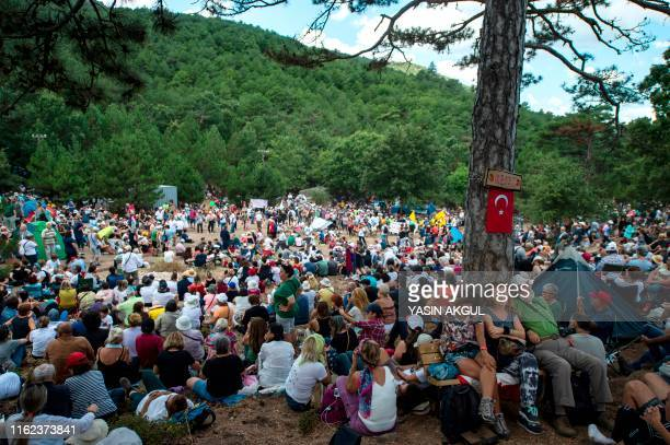 People attend a recital by Turkey's pianist and composer Fazil Say against deforestation near the town of Kirazli in Turkey's Canakkale province in...