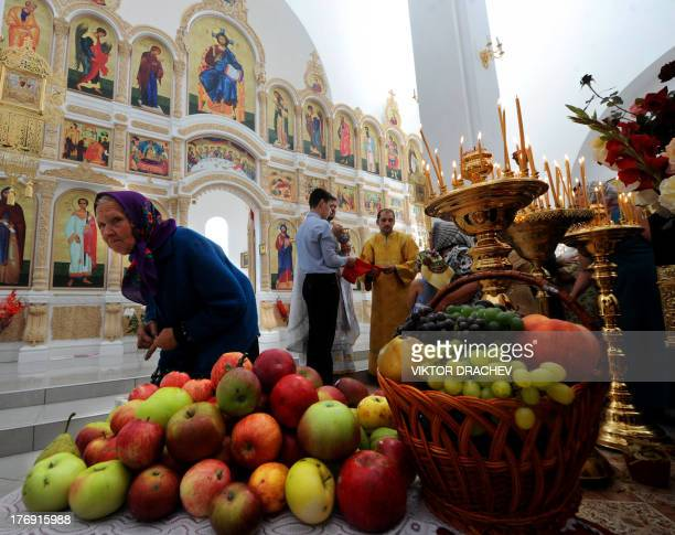 People attend a religious service marking the Transfiguration of Jesus holiday also known as Yablochny Spas inside an Orthodox cathedral in the...