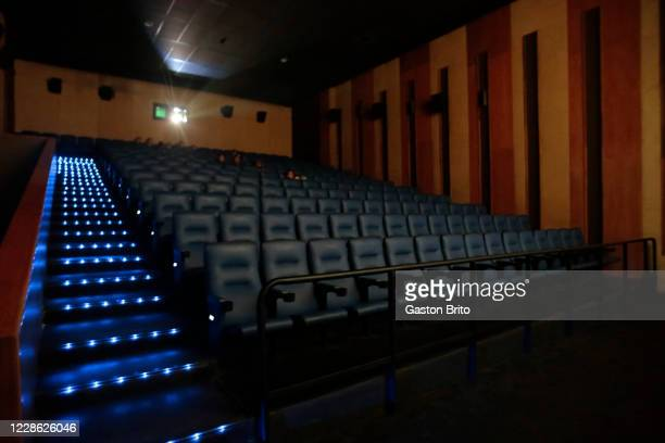 People attend a screening in a cinema during the reopening of movie theaters on September 20, 2020 in La Paz, Bolivia. The Government of La Paz has...
