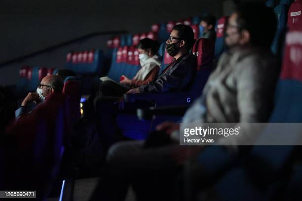 People attend a screening in the Cineteca Nacional with social distancing measures during the reopening day of cinemas en the city on August 12 2020...