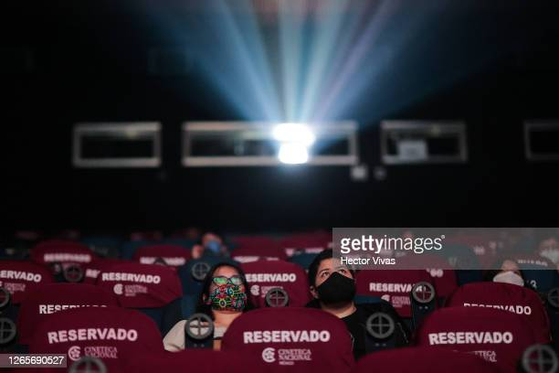 People attend a screening in the Cineteca Nacional with social distancing measures during the reopening day of cinemas en the city on August 12, 2020...