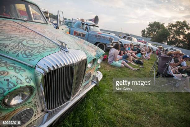 People attend a screening of film maker Julian Temple's Glastonbury documentary being shown at the new night time area Cinemaggedon at the...