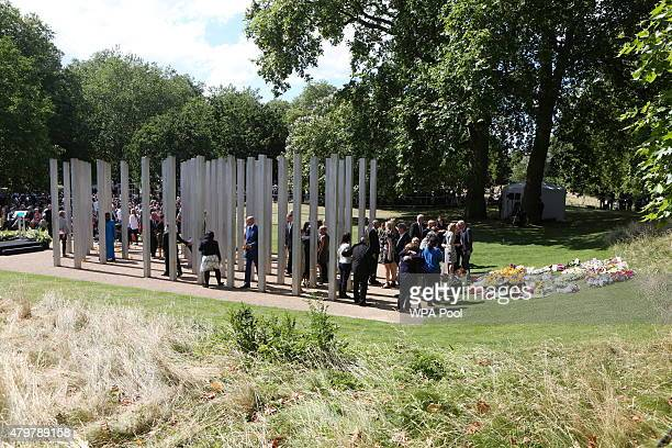 People attend a service at the July 7 memorial in Hyde Park to commemorate the tenth anniversary of the London 7/7 bombings on July 7 2015 in London...