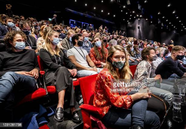 People attend a show by comedian Guido Weijers in Utrecht, as part of an experiment to study how big large events can be safe amidst the new...