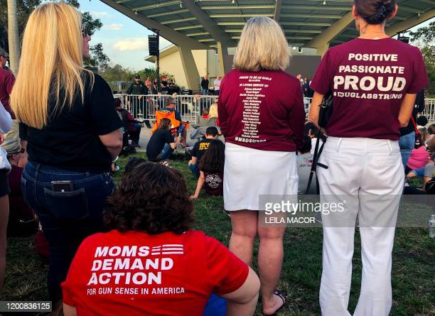People attend a spiritual service in Pine Trails Park with leaders of several faiths in tribute of the victims of Marjory Stoneman Douglas High...