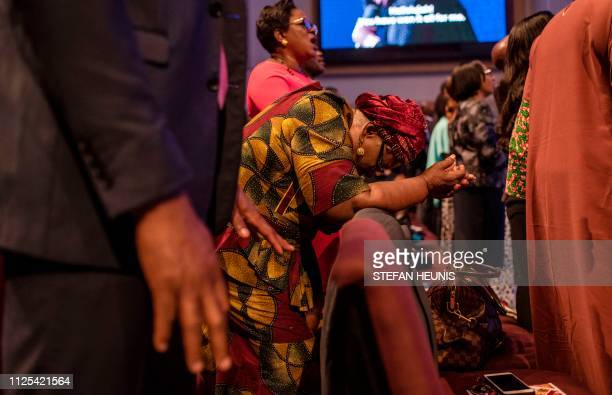 People attend a Sunday service at the House On The Rock Church in Lagos on February 17 2019 as religious leaders across Nigeria both Christian and...