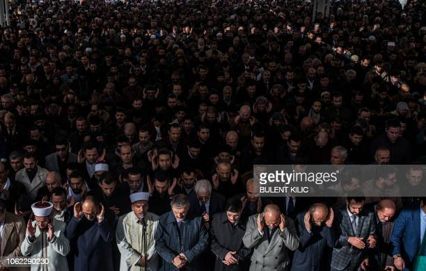 People attend a symbolic funeral prayer for Saudi journalist Jamal Khashoggi killed and dismembered in the Saudi consulate in Istanbul at the...