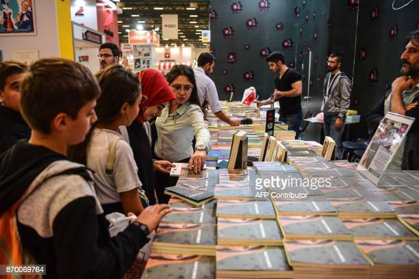 People attend a symbolic signing of the detained leader of Pro Kurdish Peoples Democratic Party Selahattin Demirtas' book 'Seher' on November 4 in...