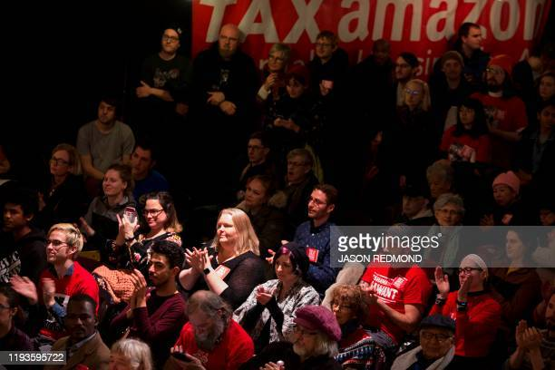 People attend a Tax Amazon 2020 Kickoff event and inauguration for Seattle City Councilmember Kshama Sawant in Seattle Washington on January 13 2020