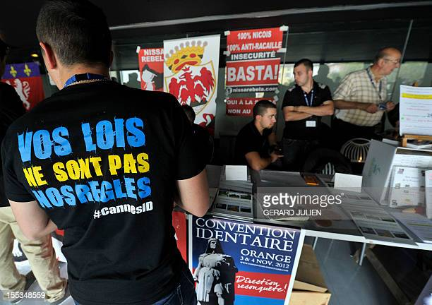 People attend a two-day convention of the French far-right organization Bloc Identitaire , on November 3, 2012 at the Palais des Princes in Orange,...