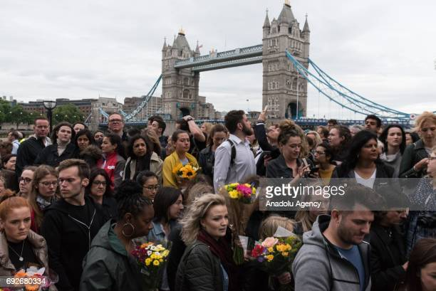 People attend a vigil at City Hall to honour victims of the London Bridge terrorist attack in London England on June 05 2017 This follows the terror...