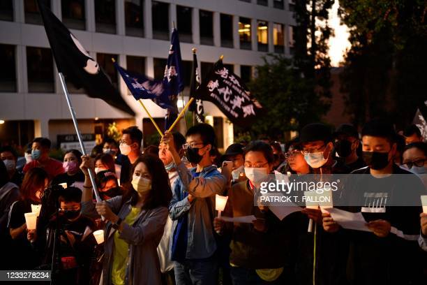 People attend a vigil commemorating the 32nd anniversary of the 1989 Tiananmen square pro-democracy protests and crackdown outside of the Chinese...