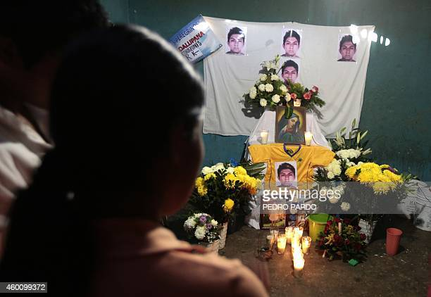 People attend a vigil for Alexander Mora one of the 43 missing students whose remains where found in a landfill in Cocula in the Tecuanapa...
