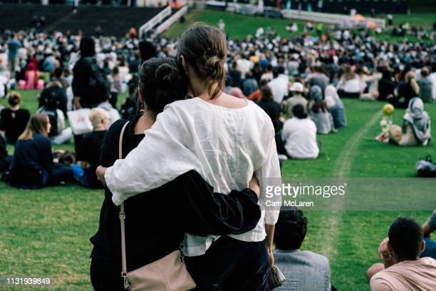 People attend a vigil for the lives taken in the Christchurch terror attacks at the Auckland Domain on March 22 2019 in Auckland New Zealand 50...