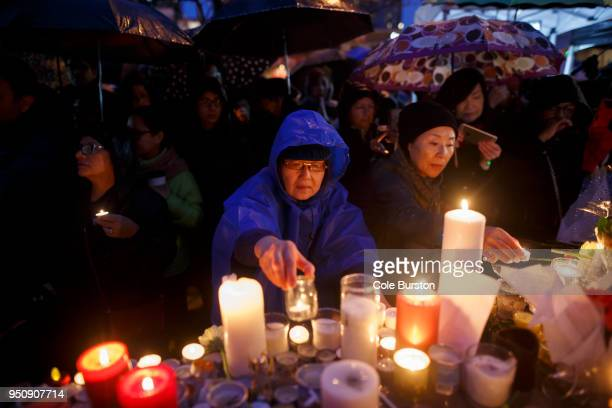 People attend a vigil for the victims of the mass killing on April 24 2018 in Toronto Canada A suspect identified by police as Alek Minassian is in...