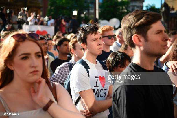 People attend a vigil in Albert Square in Manchester northwest England on May 23 in solidarity with those killed and injured in the May 22 terror...