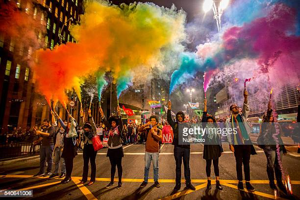 People attend a vigil in front of the Masp in Sao Paulo Brazil on June 15 in reaction to the mass shooting at a gay nightclub in Orlando Florida...