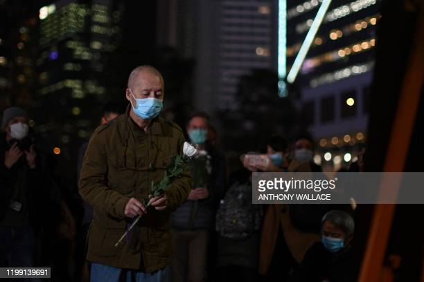People attend a vigil in Hong Kong on February 7 2020 for novel coronavirus whistleblowing doctor Li Wenliangwho died in Wuhan after contracting the...
