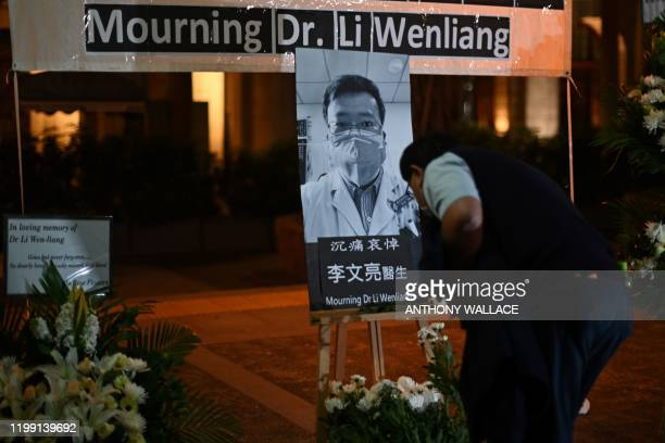 People attend a vigil in Hong Kong on February 7 2020 for novel coronavirus whistleblowing doctor Li Wenliang who died in Wuhan after contracting...
