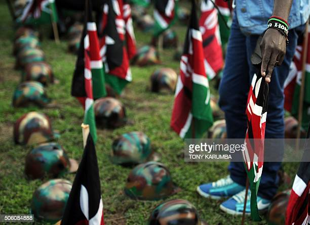 People attend a vigil on January 21 2015 in Nairobi in honour of Kenya Defence Forces soldiers killed on an African Union base in southwest Somalia's...