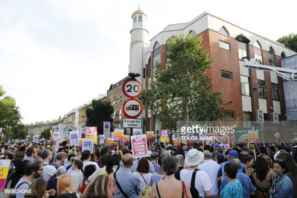 People attend a vigil outside Finsbury Park Mosque in north London on June 20 following a van attack on pedestrians nearby on June 19 Ten people were...