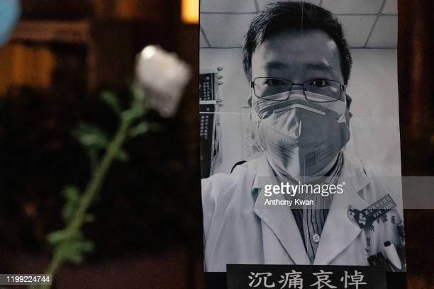 People attend a vigil to mourn for doctor Li Wenliang on February 7 2020 in Hong Kong China Doctor Li Wenliang was a Chinese ophthalmologist at Wuhan...