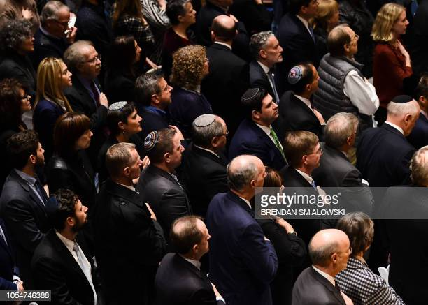 People attend a vigil to remember the victims of the shooting at the Tree of Life synagogue the day before at the Allegheny County Soldiers Memorial...
