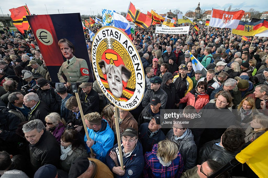 People attend a weekly Pegida demonstration on April 13, 2015 in Dresden, Germany. A large number of supporters and opponents are expected to attend the rally, which will feature Dutch right-wing politician Geert Wilders as a guest speaker. The Pegida movement, which originally emerged as a grass-roots effort with aims to curb immigration, among other issues, splintered into two camps earlier this year and the movement is seeking to regain its earlier momentum.