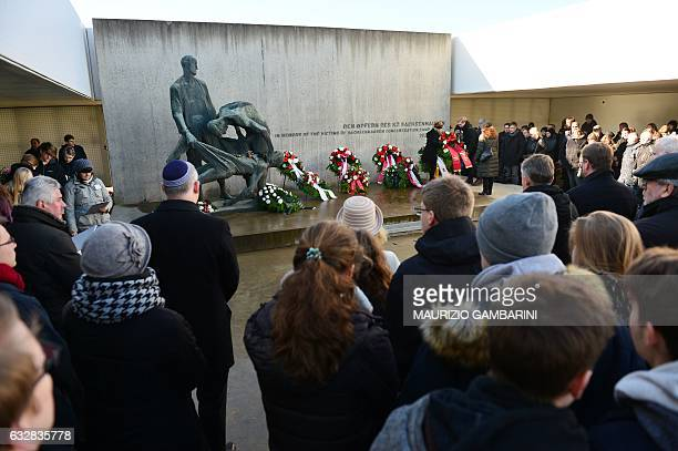 People attend a wreath laying ceremony at the Sachsenhausen memorial on the grounds of a former Nazi concentration camp in Oranienburg near Berlin on...