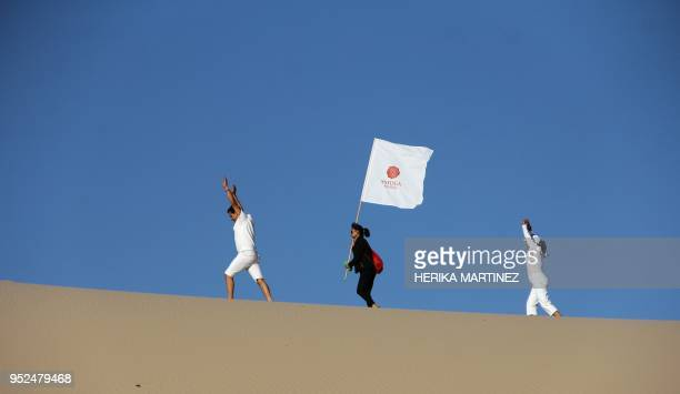 People attend a yoga class during a meeting organized by YSYoga System at the Samalayuca desert Juarez municipality Chihuahua state Mexico on April...