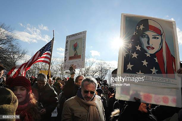 People attend an afternoon rally in Battery Park to protest US President Donald Trump's new immigration policies on January 29 2017 in New York City...