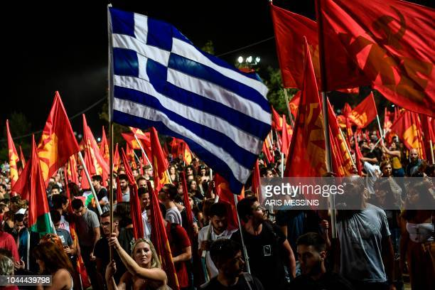 People attend an annual festival of the Greek Communist party youth wing in Athens on September 22 2018 The Greek Communist party KKE turns 100 next...