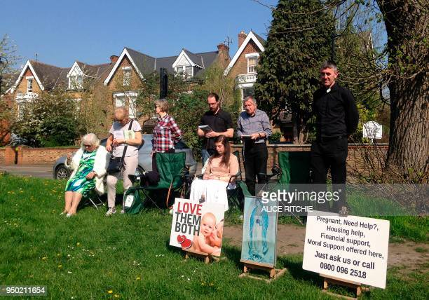 People attend an antiabortion prolife vigil on the street outside the Marie Stopes clinic that offers contraception and abortion services in Ealing...
