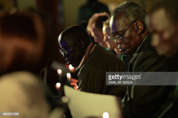 People attend an evening of remembrance to mark one year since the start of the recent conflict in South Sudan organised by Amnesty International...