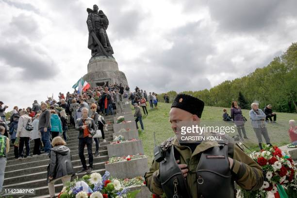 People attend an event to commemorate the 74th anniversary of the victory over Nazi Germany at the Soviet Memorial in Berlin's Treptower Park on May...