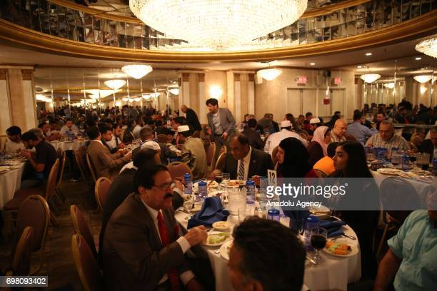 People attend an iftar dinner with New York Police Department officers during the holy month of Ramadan in Queens borough of New York United States...