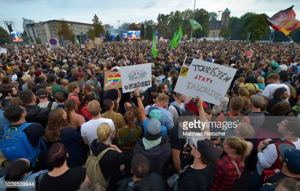"""People attend an open-air concert under the motto: """"We Are More"""" on September 3, 2018 in Chemnitz, Germany. The concert, initiated by local band..."""