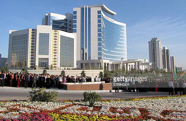 People attend an opening ceremony of the Hotel Oguzkent in Ashgabad on October 15, 2010. French industrial giant Bouygues on Friday opened a new...