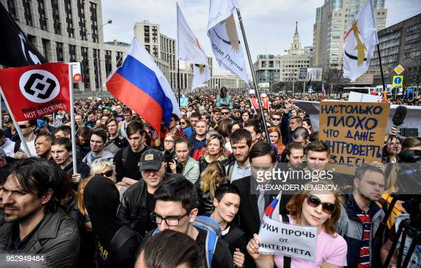 TOPSHOT People attend an opposition rally in central Moscow on April 30 to demand internet freedom in Russia Authorities tried to block access to the...
