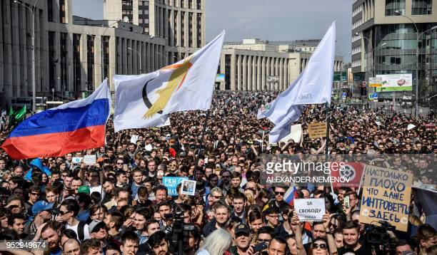 People attend an opposition rally in central Moscow on April 30 to demand internet freedom in Russia Authorities tried to block access to the popular...