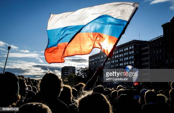 People attend an unauthorized antiKremlin rally called by opposition leader Alexei Navalny who is serving a 20day jail sentence in downtown Moscow on...