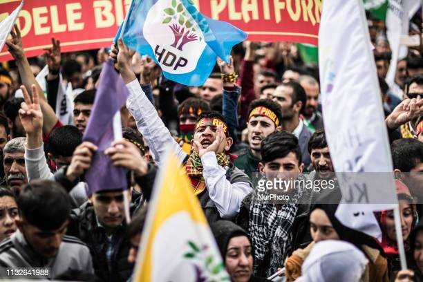 People attend and hold flags Kurdish Peoples' Democratic Party as part of the Kurdish celebration of Nowroz, in Istanbul on March 24, 2019